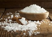 image of crystal salt  - Sea salt in bowl and spoon on a wooden background - JPG