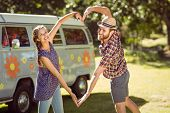 pic of love making  - Hipster couple making heart with arms on a summers day - JPG