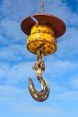stock photo of crane hook  - A large industrial crane lifting hook in Whitby harbour - JPG