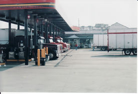 stock photo of truck-stop  - trucks refueling at the truck stop enroute to customers - JPG