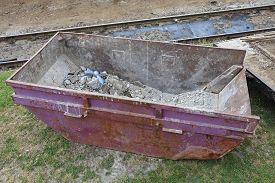 stock photo of dumpster  - Dumpster Container For Industrial Waste Collection at Construction Site - JPG