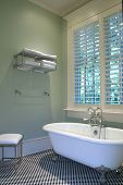 image of clawfoot  - retro bathroom with checker tile and clawfoot tub - JPG