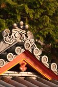 A closeup shot of a section of a Japanese temple roof