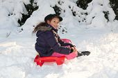 foto of toboggan  - Girl with toboggan in the snow at winter time - JPG