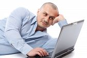 Relaxed Businessman At His Laptop