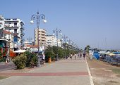 pic of larnaca  - A general view of the sea front promenade and beach at the resort of Larnaca on Cyprus. Some tourists are enjoying the sun.