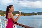 Luxury cruise ship vacation elegant woman drinking glass of champagne at dinner enjoying ocean view  poster