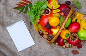 Autumn Composition: Wicker Basket With Fruits And Vegetables, Notebook, Top View. poster