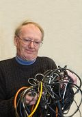 Senior man confused by tangled wires