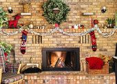 Cozy Fire In Brick Fireplace And Mantle Decorated For Christmas poster