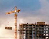 Construction Of A High-rise Building With A Crane poster