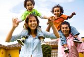 stock photo of happy family  - happy family portrait having fun outdoors at their home - JPG