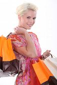 Young woman laden with store bags