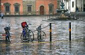 Bicycle On Town Square In Rain
