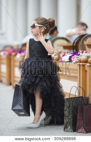 poster of Cute Little Caucasian Girl Child Having Shopping Fun.fashion Trend. Fashion Shop. Little Girl With B