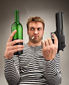 Drunk bizarre sailor choosing between bottle and gun
