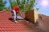 House Roof Cleaning With Pressure Tool. Worker On Top Of Building Washing Tile With Professional Equ poster