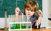 Wunderkind Experimenting With Chemistry. Boy Use Microscope Test Tubes Chemistry School Classroom. K poster
