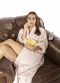 Woman Watching Tv And Eating Popcorn