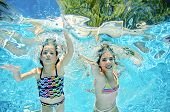 Children Swim Underwater In Swimming Pool, Happy Active Girls Have Fun Under Water, Kids Fitness And poster