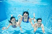 Family Swims In Pool Underwater, Happy Active Mother And Children Have Fun Under Water, Fitness And  poster
