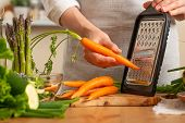 The Chef Cooks Fresh Carrots For Salad. The Concept Of Losing Healthy And Wholesome Food, Detox, Veg poster