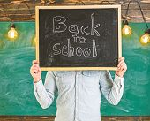 Start Of School Year Concept. Teacher Faceless Holds Blackboard With Title Back To School. Man Welco poster