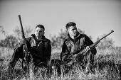 Hunters With Rifles Relaxing In Nature Environment. Hunting With Friends Hobby Leisure. Hunters Frie poster