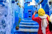 Chefchaouen, Morocco - 24.04.2019: Tourists Taking Pictures In Chefchaouen poster