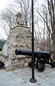 War Memorial With One Cannon.
