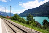 Railway track in Switzerland next to a lake