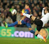 BARCELONA - FEB, 19: Alexis Sanchez(L) of FC Barcelona vies with Jordi Alba(R) of Valencia CF during
