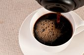 Black Espresso In A White Coffee Cup On Canvas Background