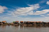 Row Of Stilt Houses Along Tonle Sap Lake