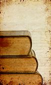 Grunge retro background with old books and copy space