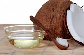stock photo of substitutes  - Coconut oil on a bamboo mat with fresh coconut - JPG