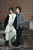 Retro Styled Fashion Portrait Of A Young Couple. Clothing And Make-up In 1920's Style.