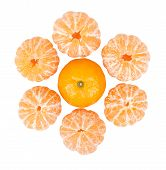 Six Peeled Mandarins And One Unbroken One Isolated