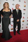LOS ANGELES - JAN 12:  Linda Kozlowski, Paul Hogan arrives at the 2013 G'Day USA Los Angeles Black T