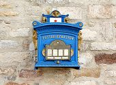 German Blue Mailbox On The Brick Wall