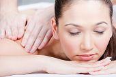 Woman receives massage treatment at beauty salon