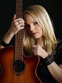 Sexy Blond Woman With Acoustic Guitar