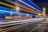 Long exposure of a bus in front of the Big Ben in London, UK