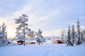 pic of laplander  - Winter landscape with house at Kiruna Sweden lapland - JPG