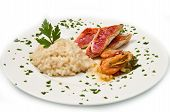 stock photo of mullet  - white dish with rice with red mullet and seafood - JPG