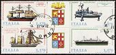 ITALY �?�¢?? CIRCA 1977: a block of four stamps printed in Italy shows illustrations of  four Italian old ships and coats of arms of Italian Royal Navy. Italy, circa 1977