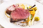 image of deer meat  - venison carree with vegetables - JPG