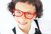 Portrait of funny little school girl wearing glasses