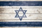 israeli flag on wood texture background