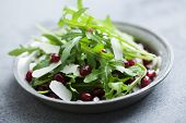 fresh rocket with pomegranate seeds and parmesan cheese